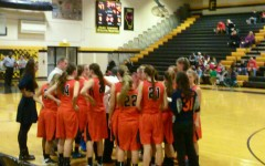 Girls basketball eliminates NCHS Redhawks from playoffs