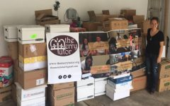 The Merry Tutor helps to replenish school libraries throughout Baton Rouge after floods