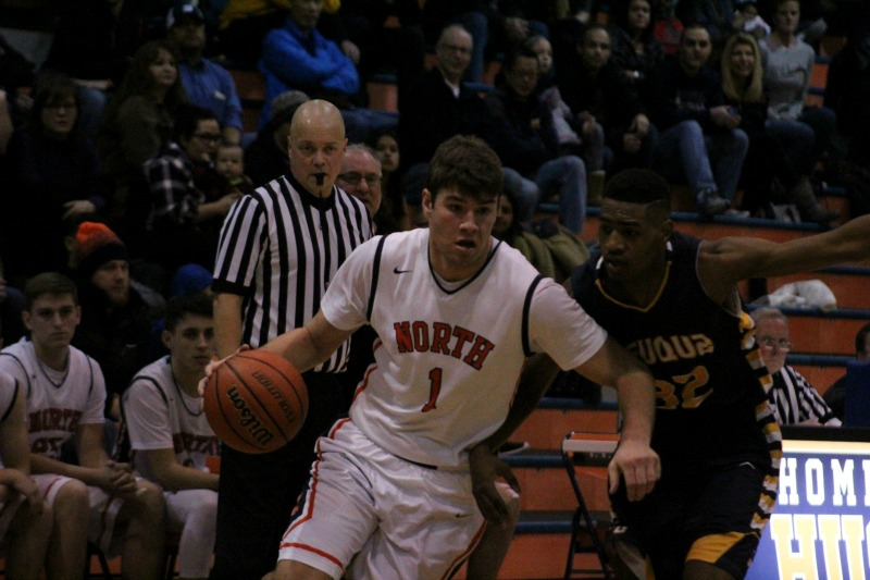 Mitch+Lewis+drives+past+Blaise+Meredith+during+Naperville+North%27s+72-63+victory+over+Neuqua+Valley%0A