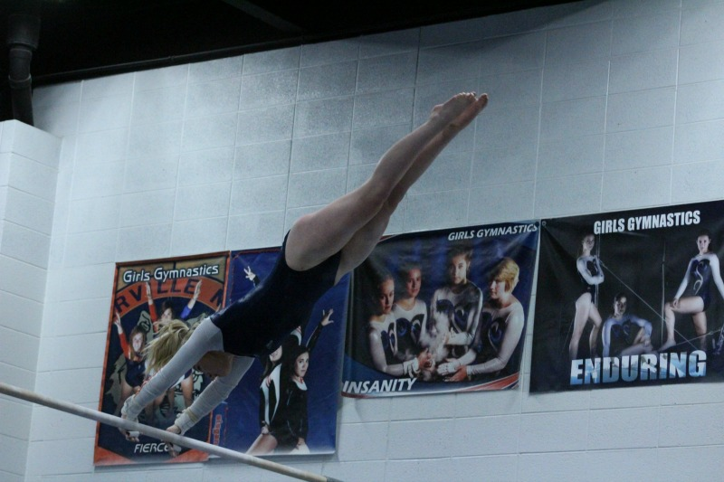 Junior+Grace+Ryan+performs+on+the+uneven+bars