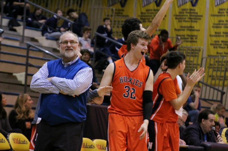 Head+Coach+Jeff+Powers+and+the+Naperville+North+boys+basketball+team+get+fired+up+during+their+66-38+win+over+Neuqua+Valley