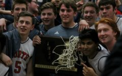 Basketball wins first sectional title in 19 years, plays Tuesday for a chance at state