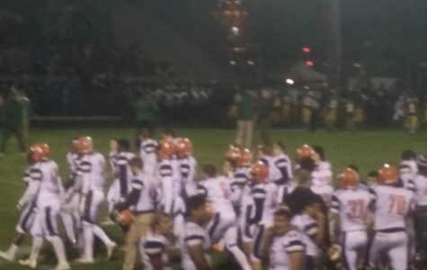 Huskies squeak by WV 17-14, continue march to playoffs