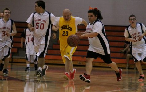 Special Olympics basketball game brings happiness to both players and fans alike
