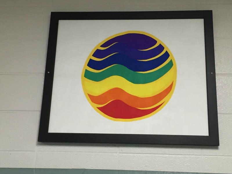 An illustration of the symbolic Universal Flag in the hallways at Naperville North