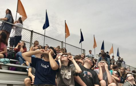 NNHS students and staff gather under Monday's solar eclipse