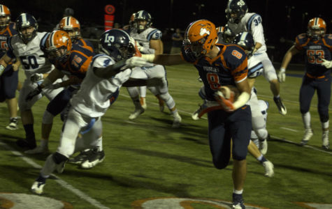 Huskie football improves to 4-0 with come-from-behind victory on Homecoming Night