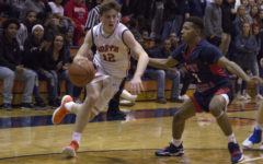 Huskie basketball defeats West Aurora Blackhawks in high-scoring game