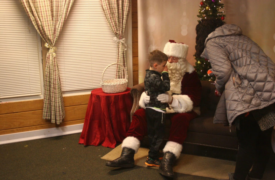 At+the+Santa+House+in+Downtown+Naperville%2C+a+child+tells+Santa+what+he+wants+for+Christmas.+Children+can+visit+with+Santa+until+December+24.