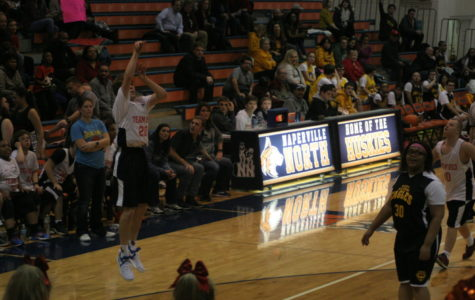 Gus Rue, 20, goes up for a three-pointer in the second half of the game against the Eagles.