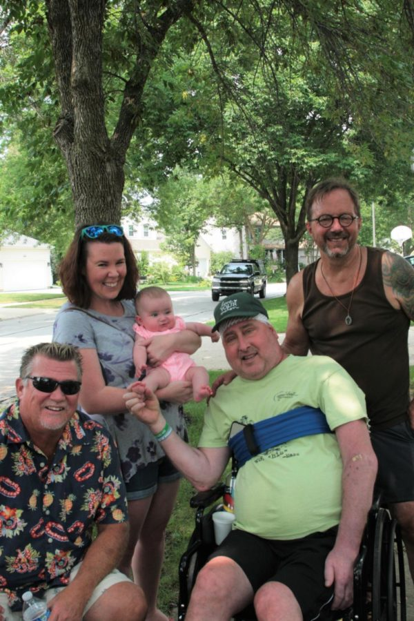 Mazzarella poses with NNHS teacher Tim Johnson, Naperville Central teacher Crystal Griffith with her daughter Waverly and Kermit Eby.   Photographed by Lily Mccormick
