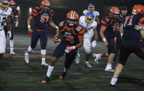 Huskies drop football season opener to Simeon Academy