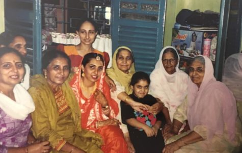 After my mom's marriage to my dad, her family poses for a picture in their one-bedroom apartment in Kolkata, India.