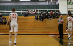 Huskie boys basketball begins playoff run with a win