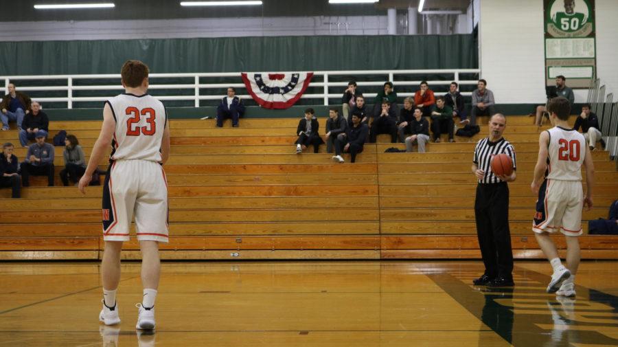Huskie+boys+basketball+begins+playoff+run+with+a+win