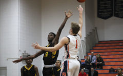 Huskie boys basketball wins big over Rich East with charity night
