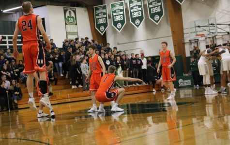 Huskie boys basketball season ends in overtime in regional semifinal
