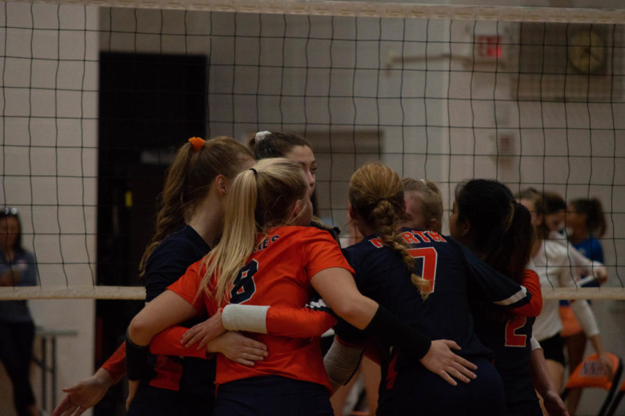Richards (8) comforts her teammates after they lose the third set and match to the Redhawks, 16-25.