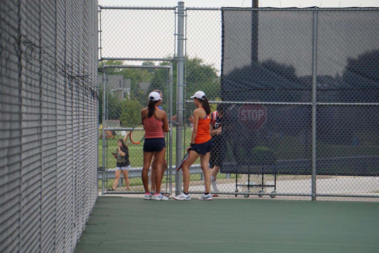 Juniors+Tiffany+Zhang+and+Irene+Zhang+get+pointers+from+Head+Coach+Heather+Henricksen+in+between+sets.+