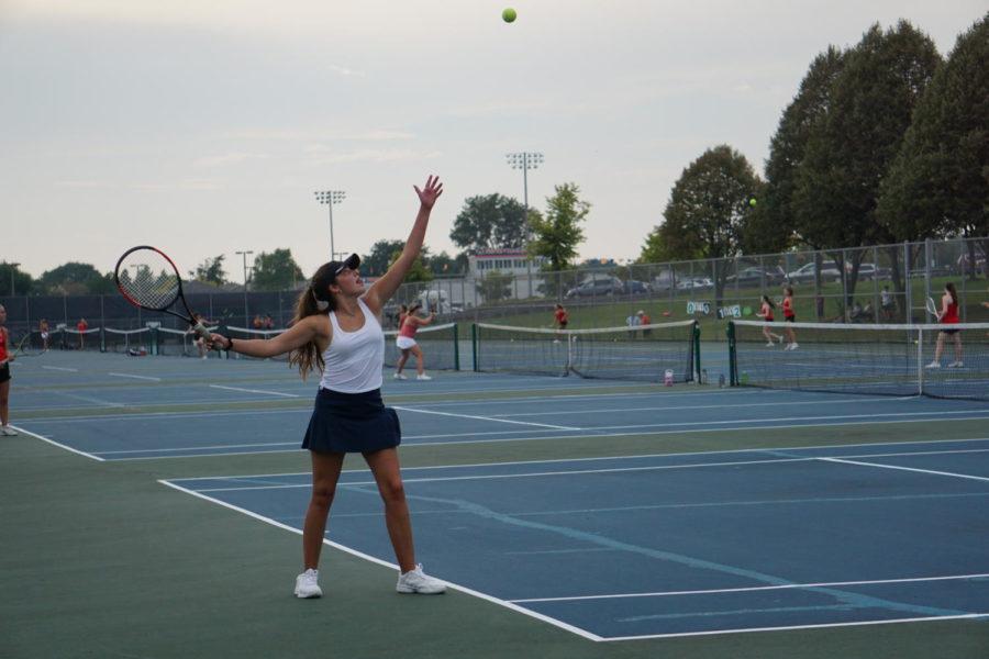 Senior Sophia Stokes serves in her match against Benet Academy.