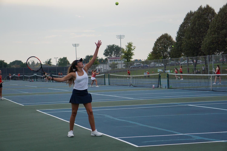 Senior+Sophia+Stokes+serves+in+her+match+against+Benet+Academy.