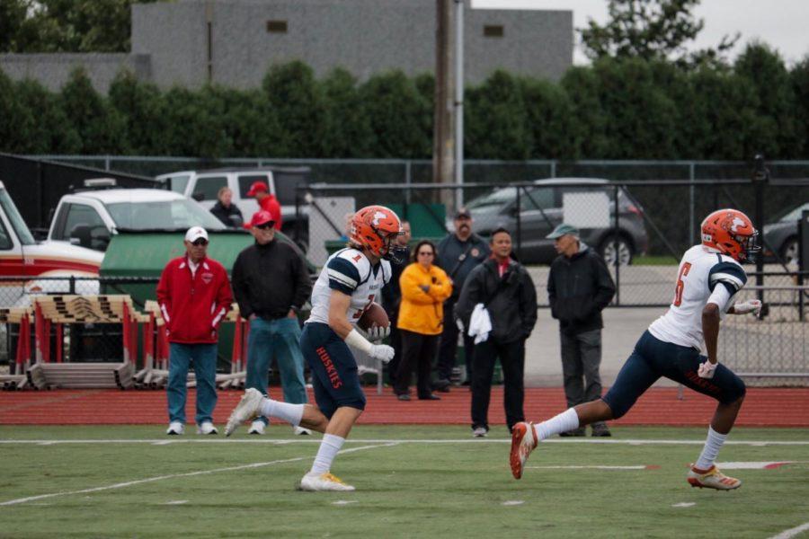 Matt Maschmeier (1) returns the kick-off after a Redhawk touchdown.