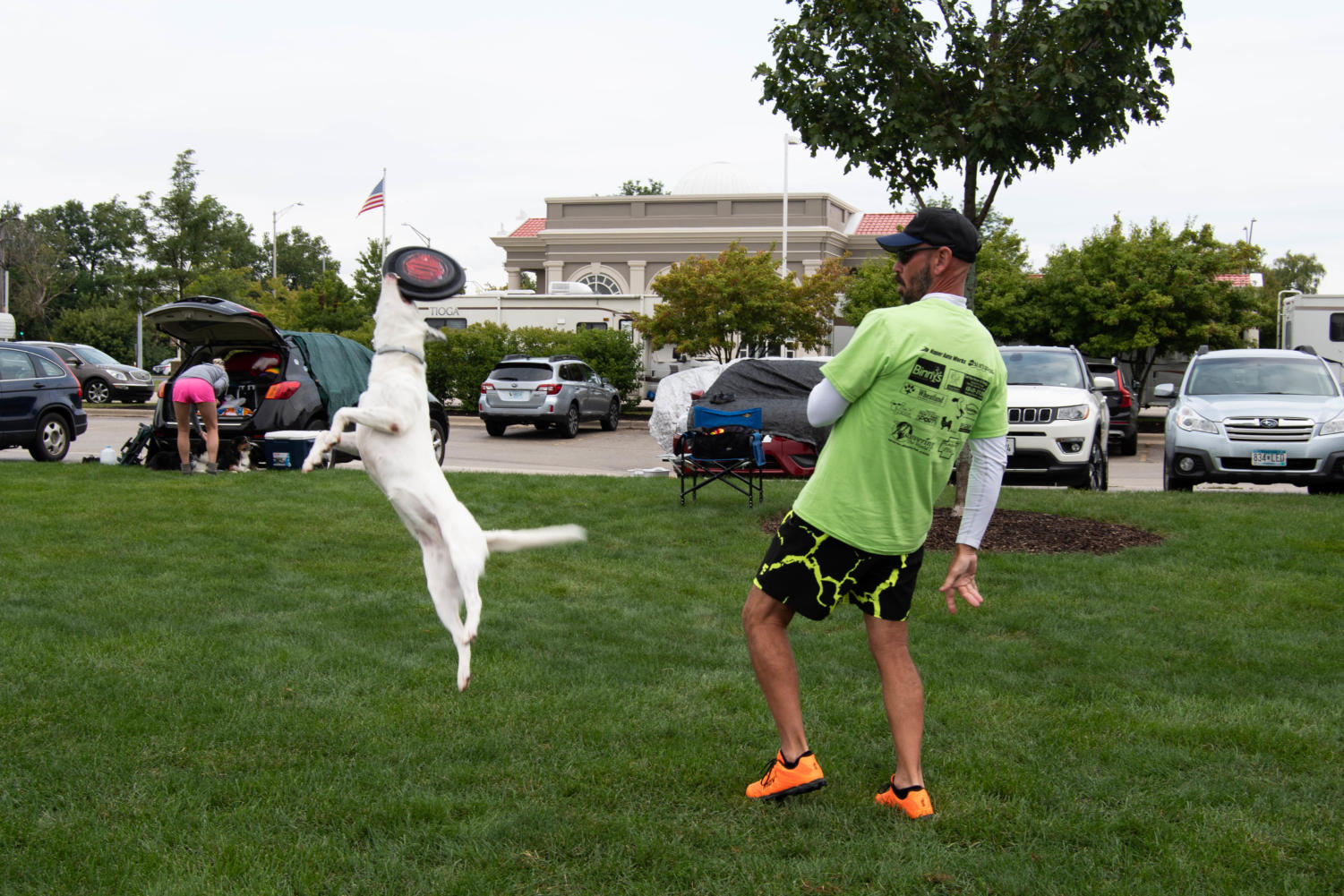Competitor+Chuck+practices+a+throw+with+his+dog+before+the+competition+starts.+