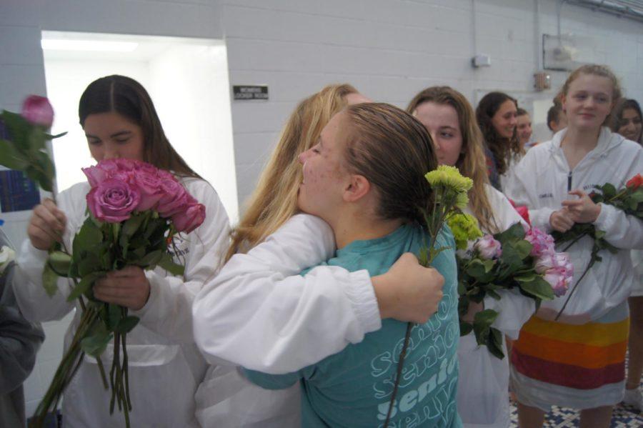 Jennings hugs freshman Maizy Spreitzer.