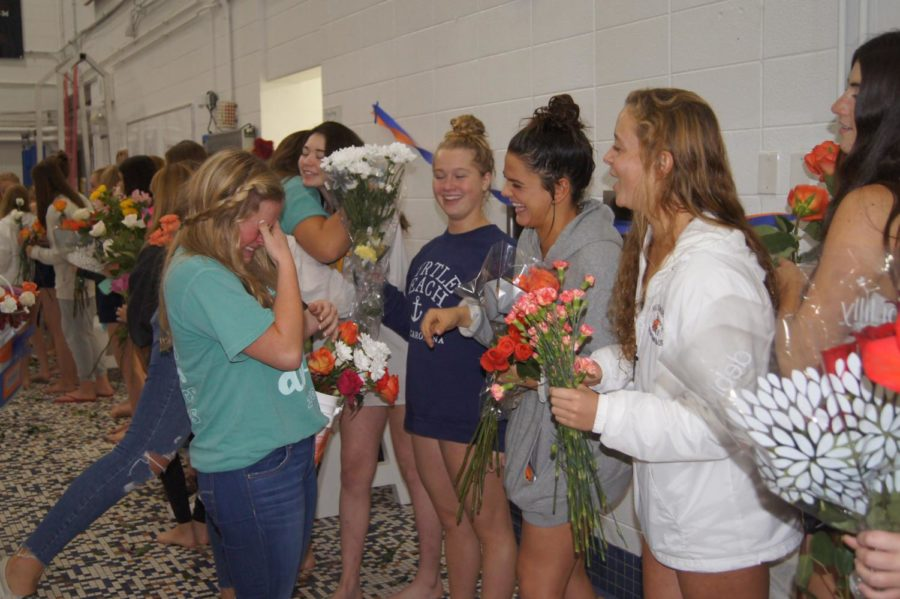 Senior Annika Swanson shares an emotional moment with her teammates. Swanson joined the team for the first time this year.