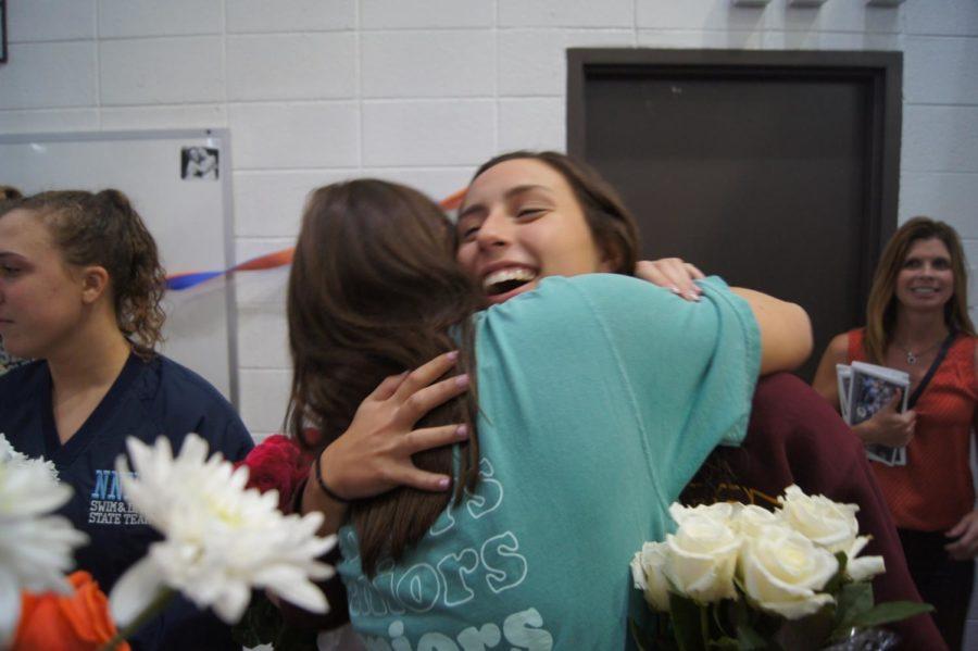 Sophomore Mia Sparacino embraces older sister Meg Sparacino.
