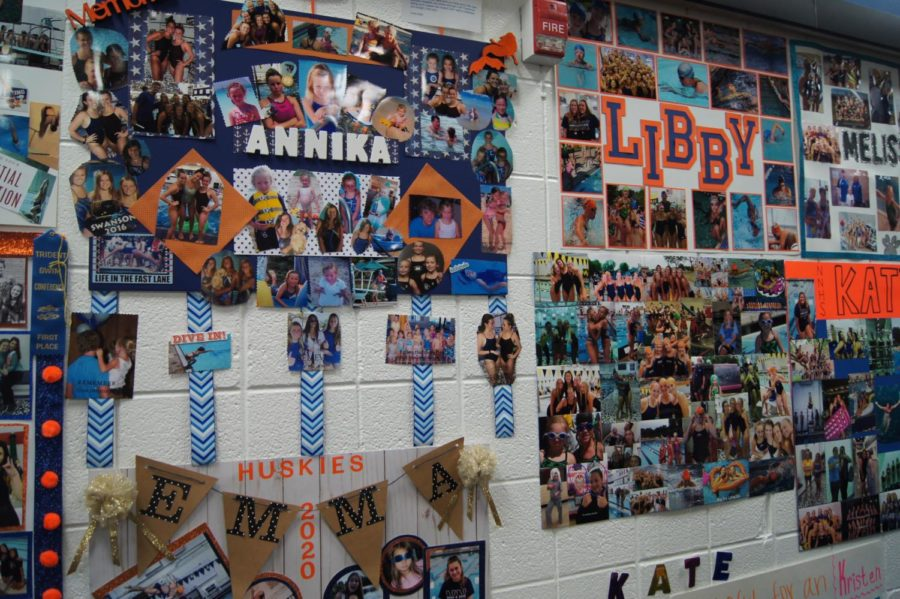 Senior posters line the wall of the hallway outside the pool deck. It is a tradition for younger swimmers and divers to make the posters for the seniors.