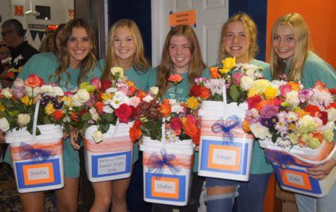 Seniors Natalie Hitchcock, Elly Laliberte, Lindsey Jennings, Lainey Eckholm and Kate Radeke pose with flowers.