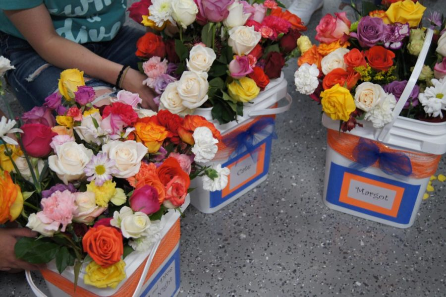 Seniors' buckets filled with flowers given to them by teammates.