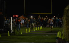 Naperville North Varsity cross country teams take home top three honors at the Twilight Invitational