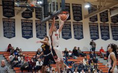 Junior Grant Johnson (1) goes up for a dunk on a breakaway.