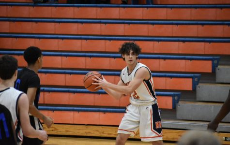Huskie boys basketball secures dominant win against Chicago Harlan