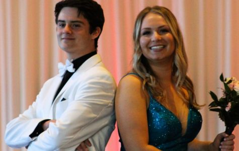 Jake Allen and Carly Richards pose together in Peaches Boutique and Men's Warehouse.