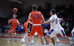 Huskies boys basketball advances in Regional Seminals with win against Wheaton North