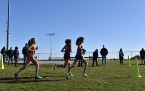 Seniors Audrey Mendrys and Maggie Gamboa take the lead early on.
