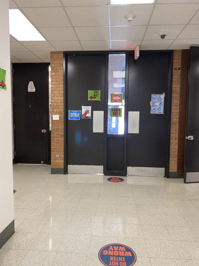 The+doors+and+hallways+in+the+school+now+boast+an+abundance+of+signs%2C+reminding+students+which+way+they+can+go%2C+proper+mask+etiquette+and+more.