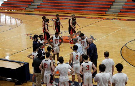 North boys basketball picks up dominant win against Benet