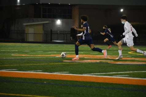 Huskie boys soccer nets a late goal in win over rival Redhawks