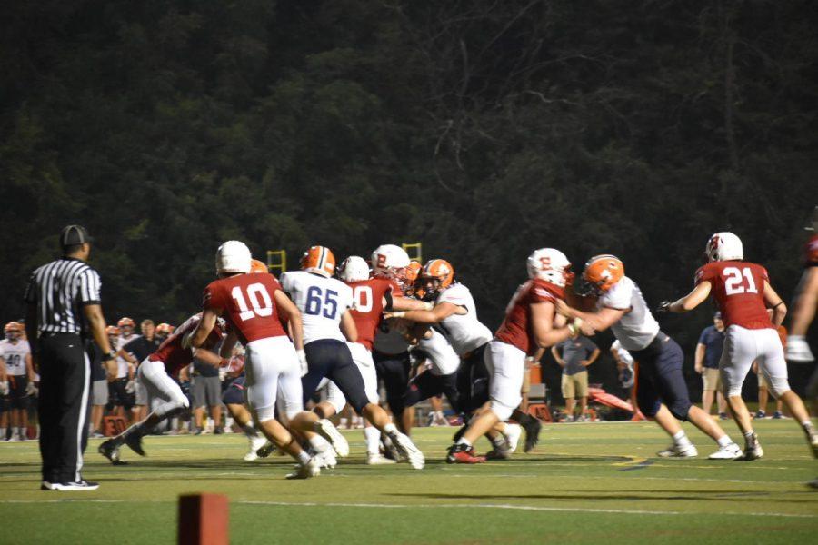 Huskie football secures win against Benet Academy in season kickoff
