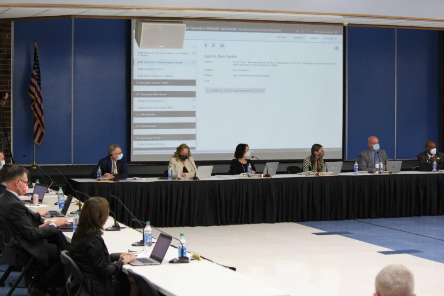 The District 203 Board of Education discusses the new schedule at the Oct. 18 board meeting.